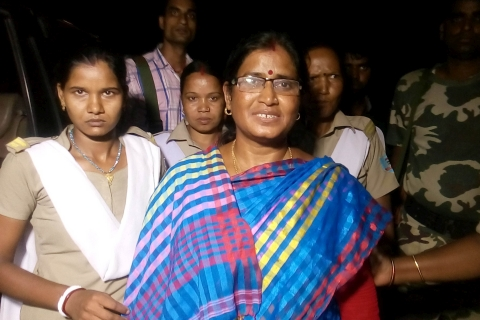 Hazaribagh, Jharkhand 25 August 2015 :: Barkagaon MLA Nirmala Devi escorted by police officials after her arresting, at Hazaribagh court of Jharkhand on Tuesday. Photo-Ratan Lal