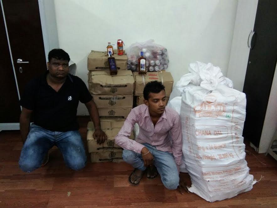 Luxury car seized with IMFL bottles