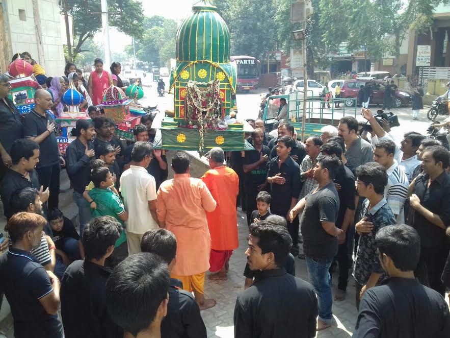 Tazia cool down by temple priest in Vadodara