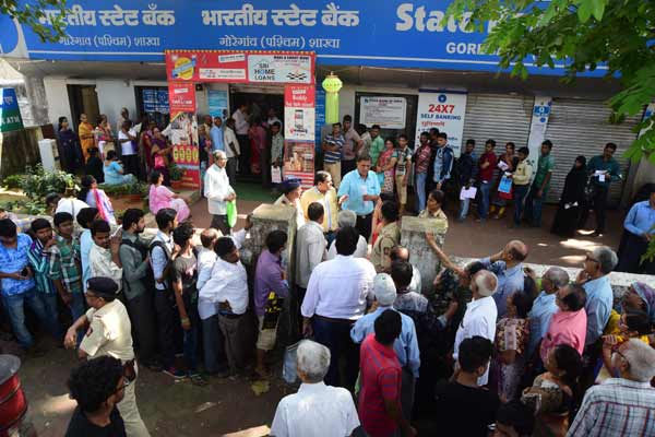 Serpentine queues, chaos outside banks on salary day