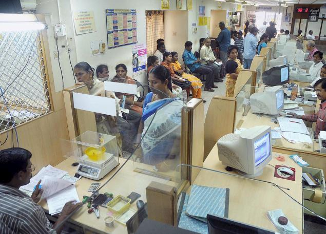 Unsung heroes: Bank staff work overtime to manage cash flow, tempers