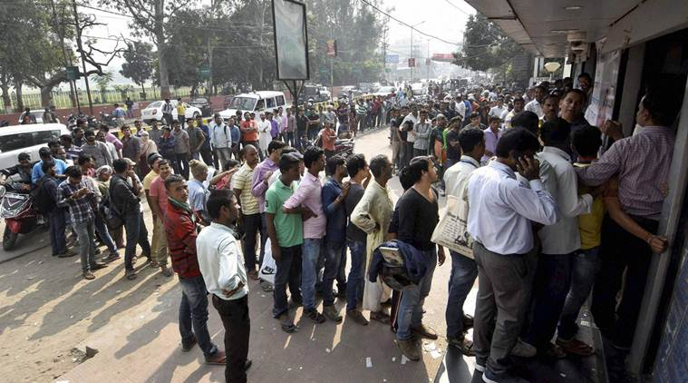 Patna: People queue up at an ATM in Patna on Saturday. PTI photo(PTI11_12_2016_000101B)