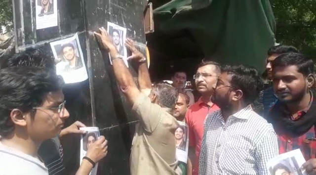 Father of missing student Devkishen Ahir stuck his posters at railway station