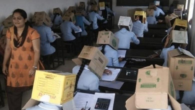 To restrict copying, Karnataka students made to write exams wearing cardboard boxes