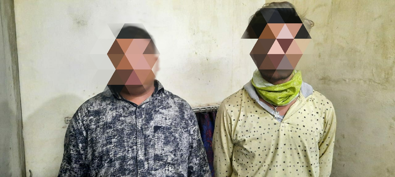 Two persons were caught with liquor hidden in a hidden pocket of a vehicle