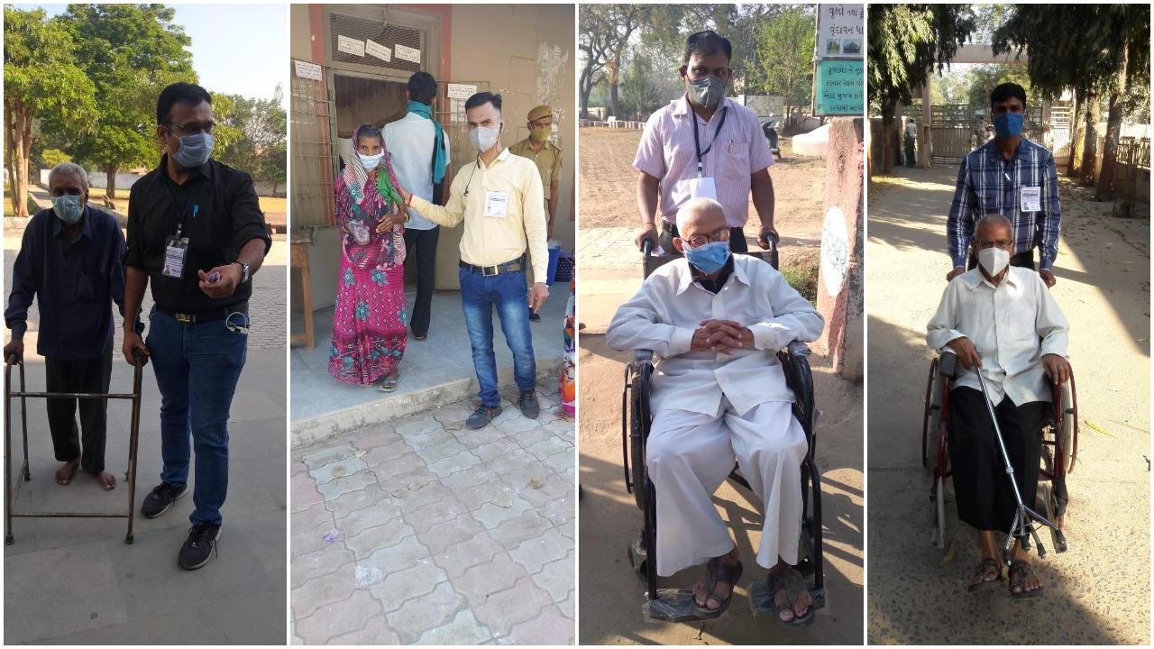 Volunteers help elderly and other voters in casting their votes in Vadodara