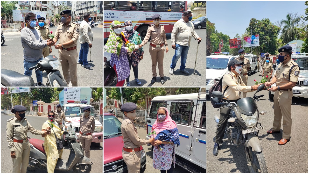 Vadodara police honoured people wearing double mask with a rose